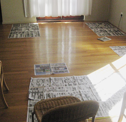 Paper prototyping a lounge/dining space with newspaper