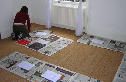 Paper prototyping a kitchen to scale with newspaper