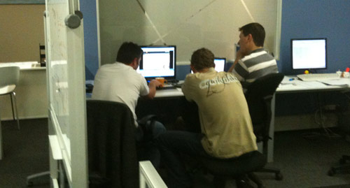 A group of developers watching usability testing video
